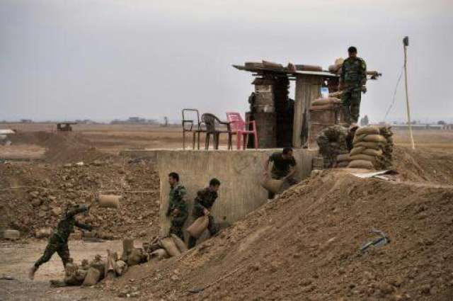 With shovels and bulldozers, Iraq Kurds draw line in sand