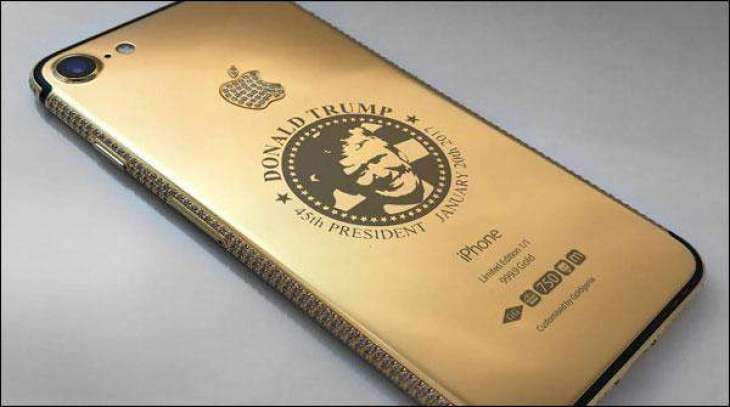 here comes gold Iphone 7 attributed to the new US president Donald trump with his picture on the back