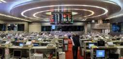 Shanghai up after China data, Asia traders on edge