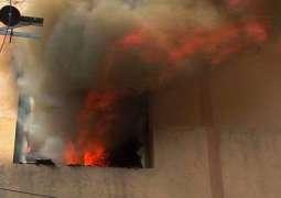 Building near Mahmood Booti Interchange caught fire, 6 dead
