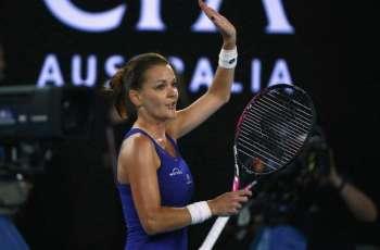 Radwanska survives test to keep Slam dream alive