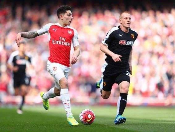 Football: Sanchez rounds off Arsenal romp over limp Swansea