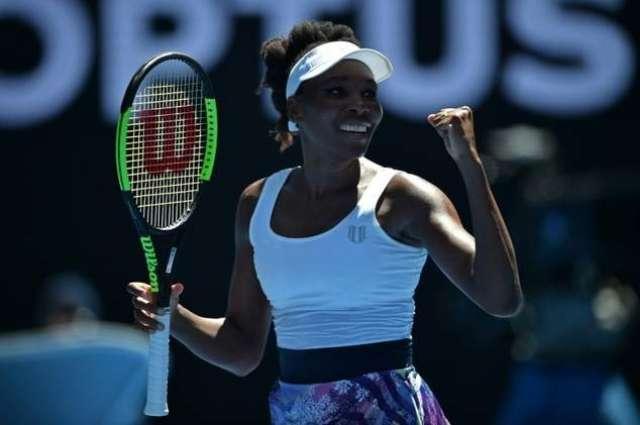 Tennis: Venus bridges age gap to reach round two