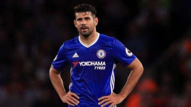 Football: Costa trains again as China row rumbles on