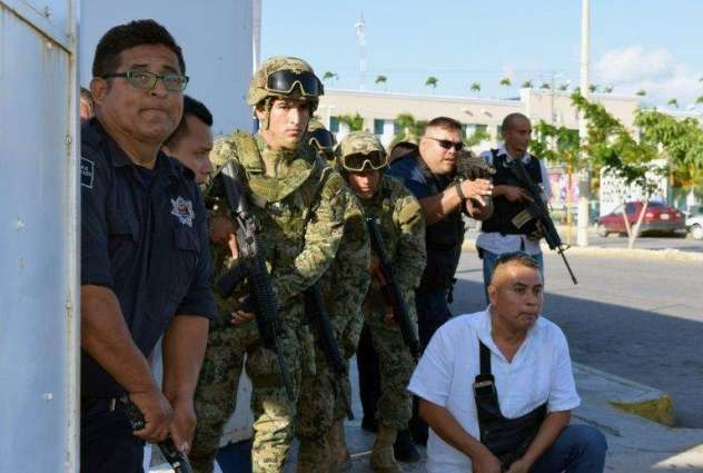 Gunman, two workers killed in attack on prosecutor's office in Cancun: official