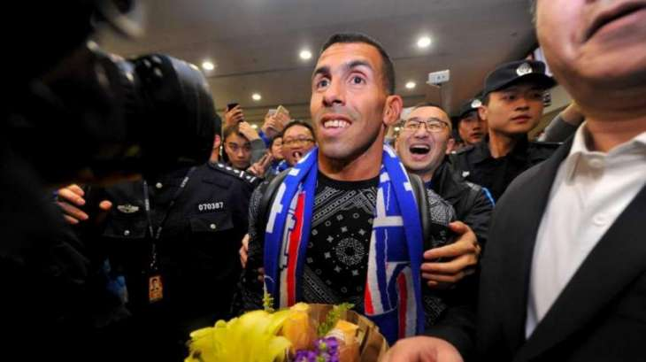 Football: Money man Tevez touches down in Shanghai
