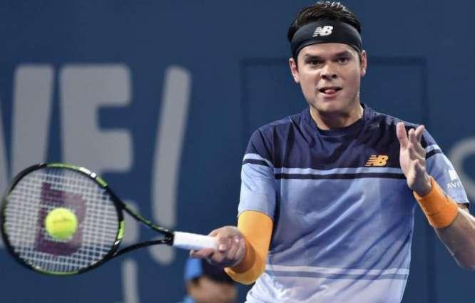 Tennis: Raonic overcomes Simon, flu to reach last 16
