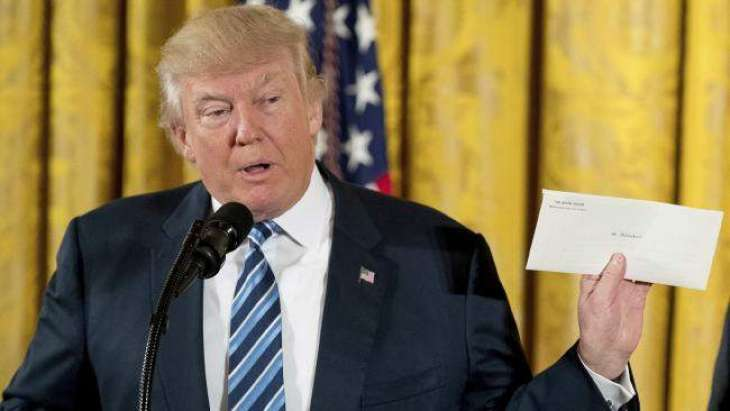 Trump vows to cherish a 'beautiful letter' left by Obama