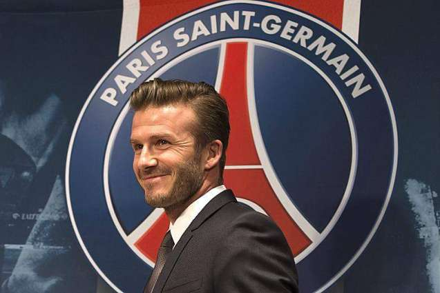 Football: Old boy Beckham drops in on PSG training