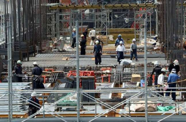 Japan says foreign workers top record 1 million