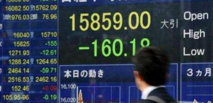 Japan stocks open lower on strong yen