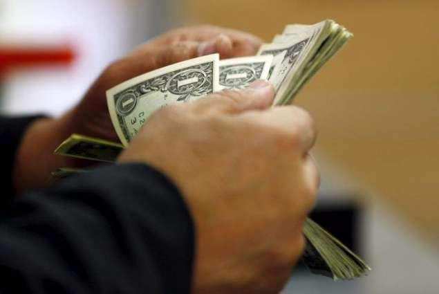 Dollar holds losses after White House trade comments