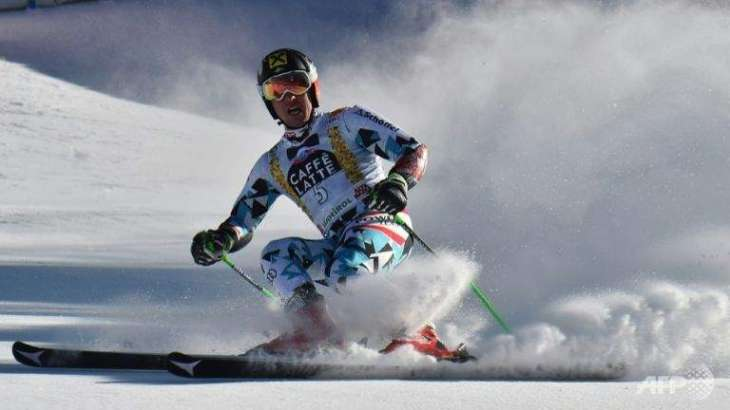 Alpine skiing: Hirscher claims first giant slalom title