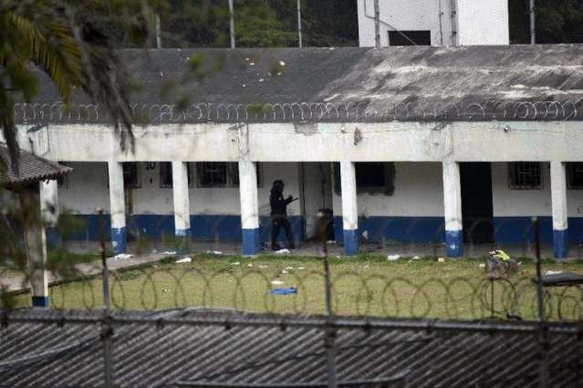 Two guards held hostage die after police raid on Guatemala prison