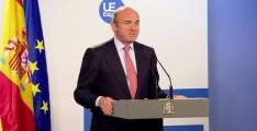 EU warns France and Spain on deficits, clears Portugal