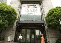 Tokyo stocks end higher ahead of holidays