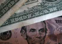 Dollar slips back against euro after Fed-fuelled gains