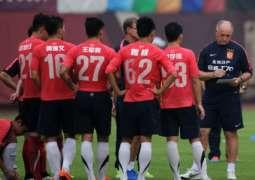 Guangzhou football fans mob departing coach Scolari