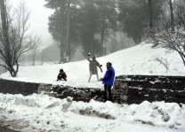 Tourists enjoying snow covered murree on weekend