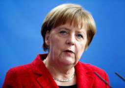 Germany's SPD agrees to exploratory govt talks with Merkel