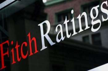 Fitch raises Irish debt rating, citing healthier banks