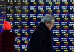 Tokyo stocks close at 26-year high as yen eases 16 January