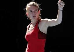 Tennis: Top seed Halep battles into Open second round