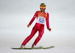 Kamil Stoch retains Olympic ski jump title at the death