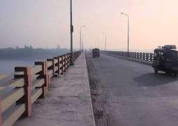 Seven injured as dumper falls off bridge in Hasanabdal