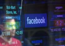 UK firm in Facebook row suspends CEO amid fresh revelations