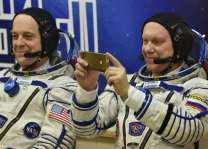 Two Americans, one Russian blast off for ISS from Kazakhstan