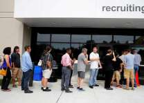 US jobless claims up slightly in tight market