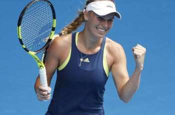 Wozniacki urges action on threatening fans