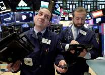 Equities wobble as US bond rates climb