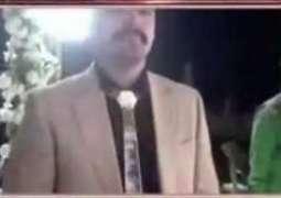Man wears gold tie, shoes on wedding