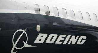 Boeing reports jump in 1Q profits, lifts 2018 forecast