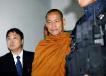 Firebrand Thai monk charged over amulet fraud