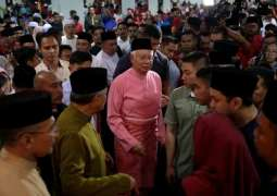 Malaysia bars scandal-plagued ousted PM from leaving country