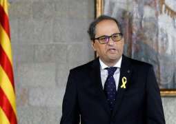 Catalan president names jailed, exiled ministers to govt