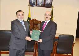 Justice Supreme Court Mustafa Mughal in his capacity as the Chief Election Commissioner presented the report of the General Elections held in Azad Jammu and Kashmir in 2016 to Sardar Masood Khan, President Azad Jammu and Kashmir at the President House here today