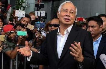 Almost $30 million, 400 handbags seized in raids linked to Malaysia's Najib