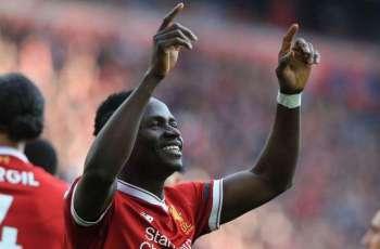 Sadio Mane sends 300 Liverpool shirts to home village