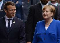 Macron wins Merkel's backing on budget for eurozone