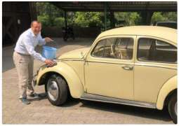 German ambassador washes car with bucket, saves water for Pakistan