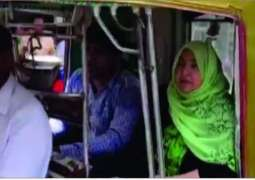 Woman candidate from NA-170 running election campaign on rickshaw