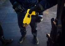US police officer uses Taser on woman, 87