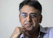 Asad Umar takes charge of his office