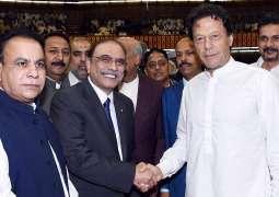 NA session: Imran Khan shakes hand with Asif Zardari