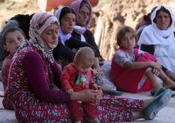 FEATURE - Iraqi Yazidis Share Memories of Sinjar Massacre by Islamic State 4 Years On