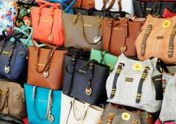 US Charges 22 for Allegedly Smuggling Fake Luxury Goods From China - Justice Dept.